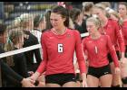A disappointed group of Harlan Community volleyball players, including seniors Haley Leinen (6) and Delaney Kelly (1) shake hands with Sergeant Bluff-Luton following the Cyclones' five-set regional semifinal defeat on Tuesday night.