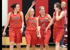 Harlan Community players Anna Ahrenholtz (53), Allison Bruck (13), Bailey Hansen (25) and Nicole Lange (11) exit the floor following Wednesday night's 4-A regional quarterfinal win over A-D-M. HCHS will play at Ballard on Saturday. (Photos by Mike Oeffner)