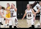 Exira-EHK sophomores Ellie Schultes (22) and Kamryn Waymire (44)  celebrate Saturday's 57-52 home win over Kuemper Catholic.