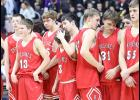 Harlan Community players react to Tuesday's 72-37 state tournament loss vs. top-seeded Norwalk at Wells Fargo Arena. (Photos by Mike Oeffner)