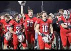 HCHS players celebrate following the team's 21-14 playoff win over Lewis Central Friday night at Merrill Field. Left-right: Wes Muenchrath (8), Lucas Stanley (32), Matt Sorfonden (36), Joseph Fah (10) and Hugh Griffith (72). (Photos by Mike Oeffner)