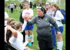 AHSTW girls soccer coach Beth Herbst high-fives her players following Tuesday's 2-0 regional tournament loss at Tri-Center. The Lady Vikes lost to the Trojans 6-1 during the regular season.