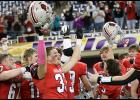 Harlan Community seniors Tyler Mumm (33) and Jesse Schwery (67) celebrate the Cyclones' 44-7 semifinal win over Boyden-Hull/Rock Valley along with sophomore Teagon Kasperbauer (11), junior Joey Moser (3) and the rest of the Cyclone players and fans. HCHS will play North Scott in the 3A title game Thursday at 7:00 p.m. (Photos by Mike Oeffner)