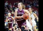 Exira-EHK sophomore Quinn Grubbs drives to the basket against Bishop Garrigan on Friday.