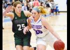 AHSTW sophomore Kinsey Scheffler (right) is guarded by IKM-Manning senior Peyton Gross during last Friday's Western Iowa Conference battle.
