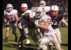 Harlan Community tailback Nick Tarney (26) runs through an opening for a chunk of his 249 yards rushing against Creston Friday night. Tarney also scored four touchdowns.