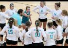 Head coach Willie Baughman talks to the Harlan Community volleyball team in a timeout during Tuesday's Teal Out match against Red Oak. The Cyclones were competitive but lost in three sets, 24-26, 14-25, 27-29.
