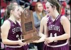 Exira-Elk Horn-Kimballton seniors Kealey Nelson (left) and Sophia Peppers smile through the tears as they accept the Spartans' state semi-finalist trophy. Together, they combined to score 2,725 points during their careers and played in four state tournaments.