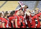 Harlan Community players hold up their Class 3A state runner-up trophy following Thursday night's title game loss to North Scott. (Photos by Mike Oeffner)
