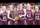 Exira-EHK seniors Sophia Peppers (41) and Kealey Nelson hold the Spartans' Class 1A state semi-finalist trophy following Friday's 57-41 loss to Springville at Wells Fargo Arena. Also pictured for Exira-EHK are Lauren Hansen (21), Leslie Caniglia (43) and Ellie Schultes (23).
