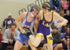 AHSTW 132-pounder Joel Becerra (left) fights for control in his match against Logan-Magnolia's Garret Thompson. (Photo courtesy of Caleb Nelson, Audubon County Newspapers)