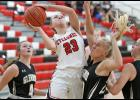 HCHS junior Raegen Wicks (23) drives between Glenwood's Elle Scarborough and Coryl Matheny to score two of her eight points during Saturday's loss to the Rams. (Photos by Mike Oeffner)
