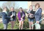 SCCS 5th graders receiving trees from Plant Iowa Committee members Bev Burmeister (far left) and Mary Illg on Friday were from left: Jaylee Schmitz, Morgan Kruse and Lauren Gaul.