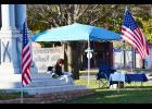 A lone reader of the Bible on the courthouse square in Harlan Friday, Nov. 11.