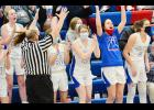 The AHSTW bench celebrates a late three-pointer during Friday night's 54-9 victory against Missouri Valley. (Photos by Bob Bjoin)