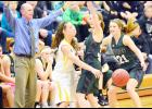 IKM-Manning coach Gene Rasmussen asks for a traveling call as Wolves' sophomore Paige Gaskill (center) and junior Aly Stadtlander (21) pressure a Tri-Center player during Friday's WIC contest.