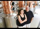 Pat and Amy Hoffmann are excited about the arrival of the still that will be the backbone of the Lonely Oak Distillery.  (Photo courtesy Jacobs Photographic)