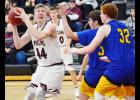 Exira-EHK junior Dakota Rold (44) looks to score against Glidden-Ralston on Friday night. Rold shot 7-of-8 from the field and led the team with 17 points as the Spartans topped the Wildcats by 35 points.