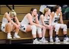 Left-right: IKM-Manning's Alexa Ahrenholtz, Bre Muhlbauer, Taylor Ferneding and Bianca Cadwell watch the final moments of Saturday's Class 2A regional game from the bench after fouling out. The Wolves made a valiant comeback to force overtime before falling to East Sac County 74-69. (Photos by Bob Bjoin)