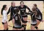 IKM-Manning players celebrate a point during Monday's five-set win against Logan-Magnolia in the WIC Tournament quarterfinals. (Photo courtesy of Todd Danner, Denison Bulletin/Review)
