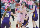 HCHS senior Clare Klein (center) tallied five points, five assists and four rebounds against Denison.