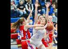 AHSTW's Kailey Jones draws contact as she goes up for a shot against I-35 Tuesday night.  (Photos by Bob Bjoin)