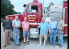 Kirkman firefighters L to R -- Chris Nelson, Mike Rasmussen, Danny Mickelson, Joe Vandenberg, Mike Norris, Don Sorensen and Adrian Nelson. Not pictured: Carol Norris, Adam Nelson, Victor McDowell and Seth Nelson.