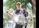 Mike Wohlhutter sits on his classic Harley Davidson.