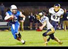 AHSTW quarterback Blake Osbahr eludes the Bulldog defense.