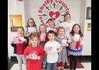 Pictured are Row 1 L to R:  Aubrey Bruck and Xavier Rosmann.     Row 2 L to R:  Halle Shields, Ashlyn Rau, Hope Reinig and Maylee Knapp.     Row 3 L to R:  Katelyn Plambeck, Nolan Muenchrath and Jaylee Schmitz.